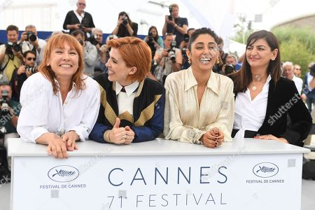 Emmanuelle Bercot, Eva Husson, Golshifteh Farahani, Didar Domehri. Actress Emmanuelle Bercot, from left, director Eva Husson, actress Golshifteh Farahani and producer Didar Domehri pose for photographers during a photo call for the film 'Girls of The Sun' at the 71st international film festival, Cannes, southern France
