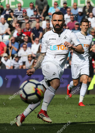 Leon Britton of Swansea City plays the ball forward
