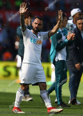 Leon Britton of Swansea City waves to the fans after his final game for the club before his retirement