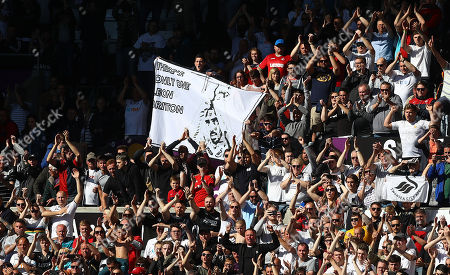 Swansea City fans with a banner for retiring Leon Britton