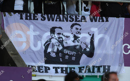 Stock Image of A Swansea City banner with the faces of Leon Britton and Angel Rangel