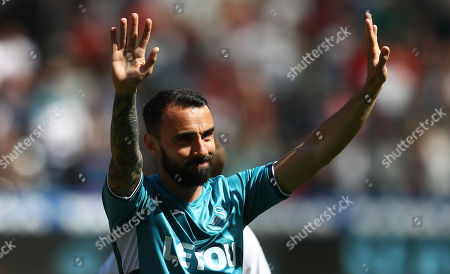 Leon Britton of Swansea City greets the fans before kick off ahead of his final game before retirement