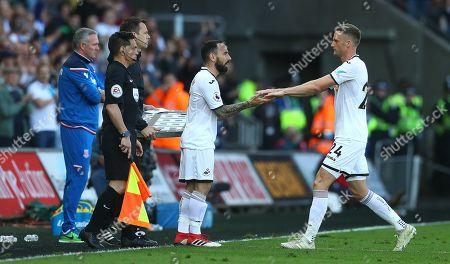 Leon Britton of Swansea City comes on for his final appearance