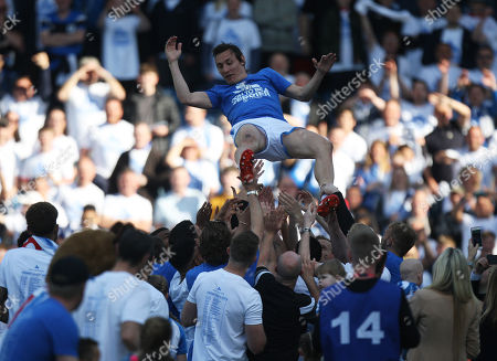 Dean Whitehead of Huddersfield Town (Top) is thrown in the air by his team mates