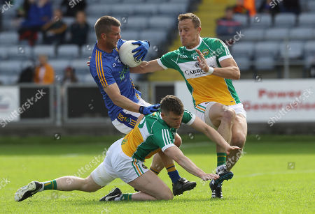 Stock Photo of Offaly vs Wicklow. Offaly's Sean Pender and Conor Carroll tackle Rory Finn of Wicklow