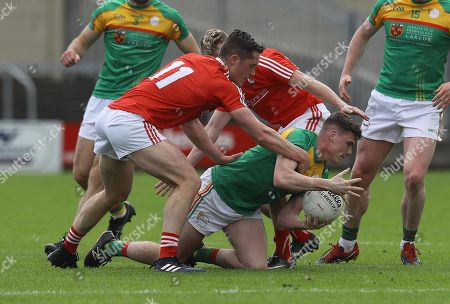 Carlow vs Louth. Carlow's Jordan Morrissey tackled by Declan Byrne and Gerard McSorley of Louth