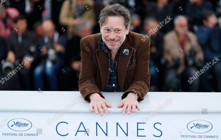 Stock Photo of French actor Mathieu Almaric poses during the photocall for 'Sink Or Swim (Le Grand Bain)' at the 71st annual Cannes Film Festival, in Cannes, France, 13 May 2018. The movie is presented out of competition at the festival which runs from 08 to 19 May.