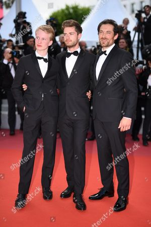 Belgian director Lukas Dhont (C), Belgian actor Victor Polster (L) and Belgian actor Arieh Worthalter arrive for the screening of 'Sink Or Swim (Le Grand Bain)' during the 71st annual Cannes Film Festival, in Cannes, France, 13 May 2018. The movie is presented out of competition at the festival which runs from 08 to 19 May.