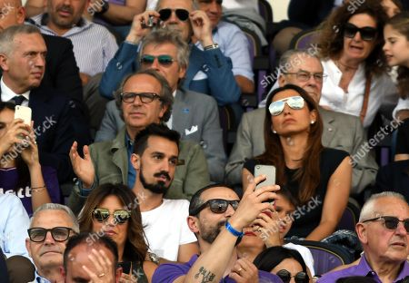 Fiorentina owner Andrea Della Valle (C-L) sits in the stands with Marco Astori (C), and Francesca Fioretti (C-R), respectively brother and wife of late Fiorentina's player Davide Astori before the Italian Serie A soccer match between ACF Fiorentina and Cagliari Calcio at the Artemio Franchi stadium in Florence, Italy, 13 May 2018.