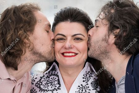 Saad Lostan, Metin Akdulger, Gaya Jiji. Actors Saad Lostan and Metin Akdulger kiss director Gaya Jiji during during a photo call for the film 'My Favorite Fabric' at the 71st international film festival, Cannes, southern France