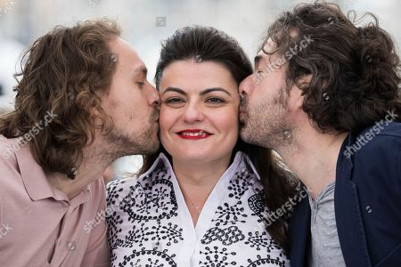 Stock Picture of Saad Lostan, Metin Akdulger, Gaya Jiji. Actors Saad Lostan and Metin Akdulger kiss director Gaya Jiji during during a photo call for the film 'My Favorite Fabric' at the 71st international film festival, Cannes, southern France