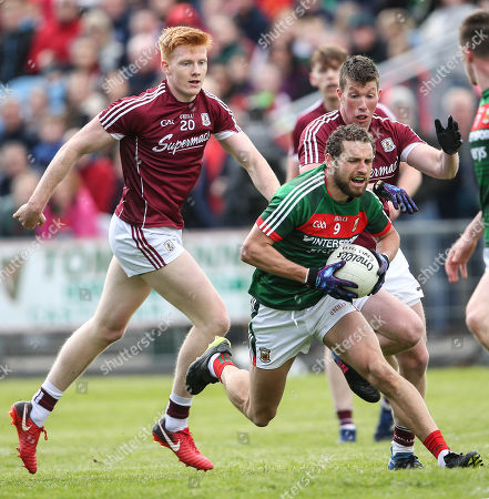 Mayo vs Galway. Mayo's Tom Parsons is tackled by Peter Cooke and Gareth Bradshaw of Galway