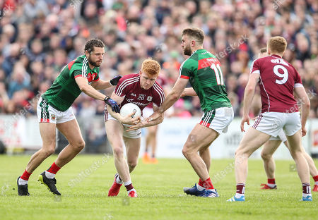 Mayo vs Galway. Mayo's Tom Parsons and Paul Conroy tackle Peter Cooke of Galway