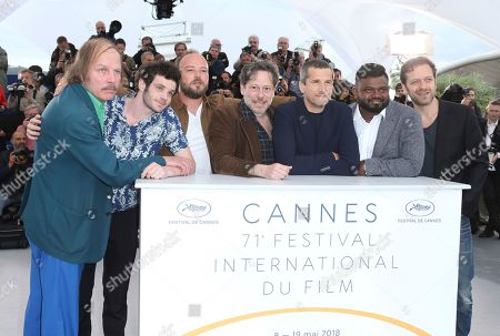 Philippe Katerine, Felix Moati, Alban Ivanov, Mathieu Amalric, Guillaume Canet, Thamilchelvan Balasingham, Jonathan Zaccai. Actors Philippe Katerine, from left, Felix Moati, Alban Ivanov, Mathieu Amalric, Guillaume Canet, Thamilchelvan Balasingham, and Jonathan Zaccai pose for photographers during a photo call for the film 'Sink or Swim' at the 71st international film festival, Cannes, southern France