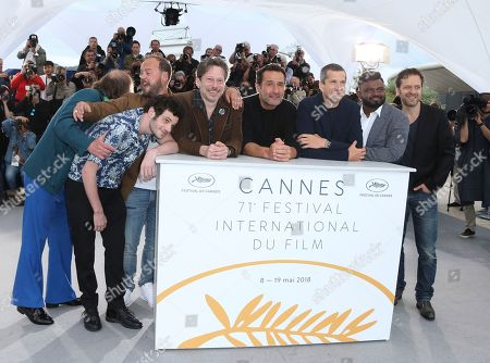 Philippe Katerine, Felix Moati, Alban Ivanov, Mathieu Amalric, Guillaume Canet, Thamilchelvan Balasingham, Jonathan Zaccai. Actors Philippe Katerine, from left, Felix Moati, Alban Ivanov, Mathieu Amalric, director Gilles Lellouche, actors Guillaume Canet, Thamilchelvan Balasingham, and Jonathan Zaccai pose for photographers during a photo call for the film 'Sink or Swim' at the 71st international film festival, Cannes, southern France
