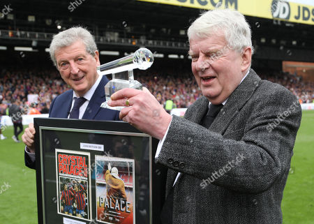 Crystal Palace manager Roy Hodgson awards a framed montage and glass microphone to retiring TV commentator John Motson