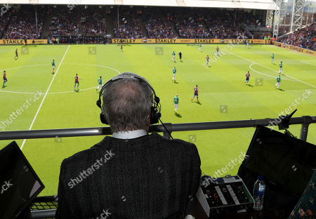 TV and radio commentator John Motson during his last commentary football match after 50 years