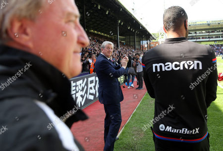 Crystal Palace manager Roy Hodgson walks onto the pitch with his coaching staff of Stephen Reid and Ray Lewington
