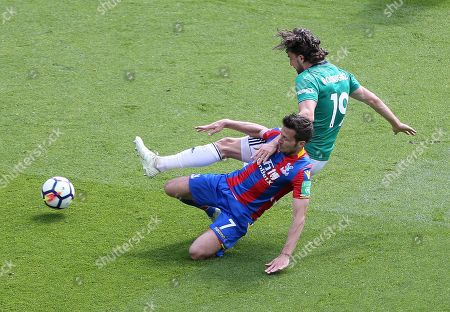 Yohan Cabaye of Crystal Palace tackles Jay Rodriguez of West Bromwich Albion