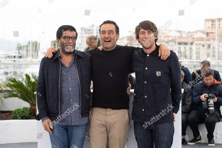Director Gilles Lellouche (C) poses with producers Hugo Selignac (R) and Alain Attal (L)