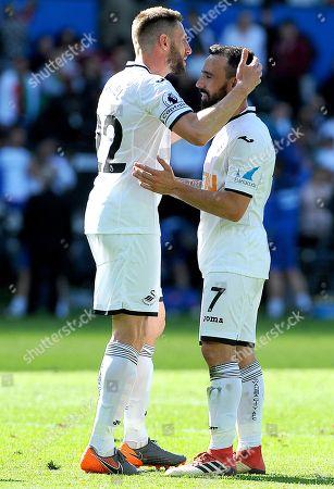 Angel Rangel of Swansea City praises Leon Britton of Swansea City at the final whistle