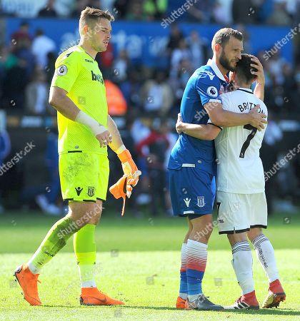 Erik Pieters of Stoke City hugs Leon Britton of Swansea City after the final whistle -Mandatory by-line: Nizaam Jones/JMP- 13/05/2018