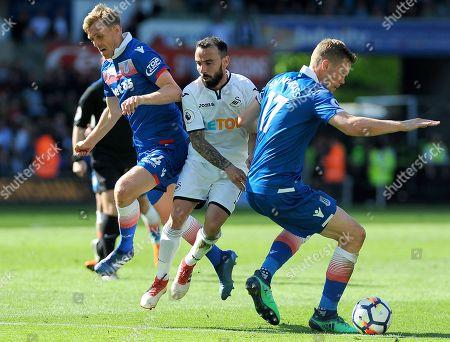 Leon Britton of Swansea is challenged by Ryan Shawcross of Stoke City -Mandatory by-line: Nizaam Jones/JMP- 13/05/2018