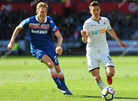 Darren Fletcher of Stoke City competes with Tom Carroll of Swansea City -Mandatory by-line: Nizaam Jones/JMP- 13/05/2018