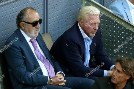 Owner of Mutua Madrid Open, Romanian Ion Tiriac (L), and German tennis legend Boris Becker, during the Mutua Madrid Open Men's final match played between German tennis player Alexander Zverev and Austrian Dominic Thiem at Caja Magica in Madrid, Spain, 13 May 2018.