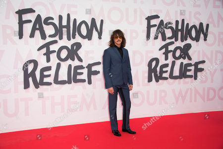Casey Spooner poses for photographers upon arrival at the Fashion For Relief 2018 event during the 71st international film festival, Cannes, southern France