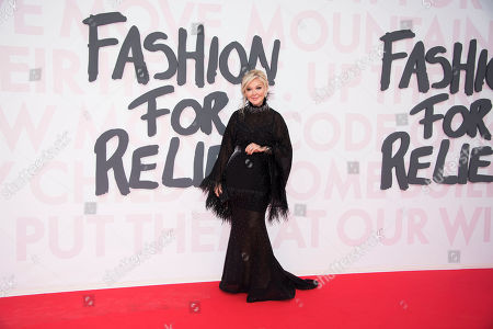 Yulia Yanina poses for photographers upon arrival at the Fashion For Relief 2018 event during the 71st international film festival, Cannes, southern France