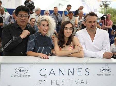 Victor Lopez, Romina Iniesta, Tania Casciani, Stephane Rideau. Actors Victor Lopez, from left, Romina Iniesta, Tania Casciani and Stephane Rideau pose for photographers during a photo call for the film 'Murder Me, Monster' at the 71st international film festival, Cannes, southern France