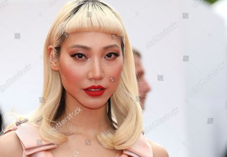 Joey Yung poses for photographers upon arrival at the premiere of the film 'Sink or Swim' at the 71st international film festival, Cannes, southern France