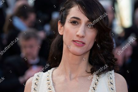 Director Deniz Gamze Erguven poses for photographers upon arrival at the premiere of the film 'Sink or Swim' at the 71st international film festival, Cannes, southern France