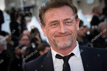 Jean-Paul Rouve poses for photographers upon arrival at the premiere of the film 'Sink or Swim' at the 71st international film festival, Cannes, southern France