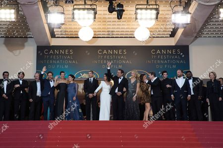 Philippe Katerine, Jonathan Zaccai, Melanie Doutey, Noee Abita, Guillaume Canet, Leila Bekhti, Gilles Lellouche, Benoit Poelvoorde, Virginie Efira, Marina Fois, Mathieu Amalric, Felix Moati, Alban Ivanov, Thamilchelvan Balasingham. Philippe Katerine, Jonathan Zaccai, Melanie Doutey, Noee Abita, Guillaume Canet, Leila Bekhti, Gilles Lellouche, Benoit Poelvoorde, Virginie Efira, Marina Fois, Mathieu Amalric, Felix Moati, Alban Ivanov and Thamilchelvan Balasingham pose for photographers upon arrival at the premiere of the film 'Sink or Swim' at the 71st international film festival, Cannes, southern France
