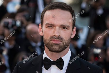 Alban Lenoir poses for photographers upon arrival at the premiere of the film 'Sink or Swim' at the 71st international film festival, Cannes, southern France