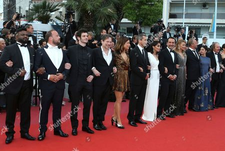 Balasingham Thamilchelvan, Alban Ivanov, Felix Moati, Mathieu Amalric, Marina Fois, Guillaume Canet, Leila Bekhti, Gilles Lellouche, Virginie Efira, Benoit Poelvoorde, Noee Abita, Philippe Katerine. Actors Balasingham Thamilchelvan, from left, Alban Ivanov, Felix Moati, Mathieu Amalric, Marina Fois, Guillaume Canet, Leila Bekhti, director Gilles Lellouche, actors Virginie Efira, Benoit Poelvoorde, Noee Abita, and Philippe Katerine pose for photographers upon arrival at the premiere of the film 'Sink or Swim' at the 71st international film festival, Cannes, southern France