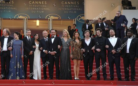 Philippe Katerine, No'e Abita, Guillaume Canet, Leila Bekhti, Benoit Poelvoorde, Gilles Lellouche, Virginie Efira, Melanie Doutey, Mathieu Amalric, Felix Moati, Alban Ivanov, Balasingham Thamilchelvan. Actors Philippe Katerine, from left, Noee Abita, Guillaume Canet, Leila Bekhti, Benoit Poelvoorde, director Gilles Lellouche, actors Virginie Efira, Melanie Doutey, Mathieu Amalric, Felix Moati, Alban Ivanov, and Balasingham Thamilchelvan pose for photographers upon arrival at the premiere of the film 'Sink or Swim' at the 71st international film festival, Cannes, southern France