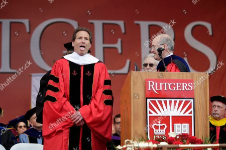 Dan Schulman, CEO of PayPal, reacts as he receives an honorary degree during a Rutgers University graduation ceremony in Piscataway Township, N.J., . Family and friends watched as over 18,000 graduates received their degrees on Mother's Day