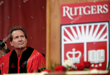 Dan Schulman, CEO of PayPal, participates in a Rutgers University graduation ceremony in Piscataway Township, N.J., . Family and friends watched as over 18,000 graduates received their degrees on Mother's Day