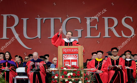 Dan Schulman, CEO of PayPal, speaks during a Rutgers University graduation ceremony in Piscataway Township, N.J., . Family and friends watched as over 18,000 graduates received their degrees on Mother's Day