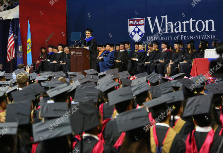 "Chobani Founder and CEO Hamdi Ulukaya addresses graduates, families and faculty at the 2018 Wharton MBA Graduation Ceremony, in Philadelphia. In his remarks, Ulukaya said ""We are entering a new era, when the center of gravity for social change has moved to the private sector. It's business, not government, that is in the best position to lead today"