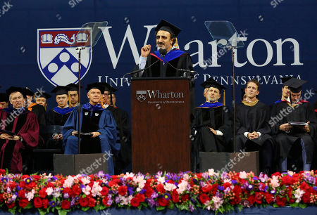 "Chobani Founder and CEO Hamdi Ulukaya addresses graduates, families and faculty at the 2018 Wharton MBA Graduation Ceremony, in Philadelphia. In his remarks, Ulukaya said ""Everything we need to write the next great chapter for this country, and this planet, already exists in towns and communities, just waiting to be awakened"