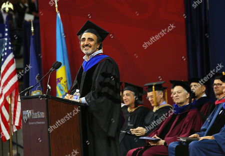 "Chobani Founder and CEO Hamdi Ulukaya addresses graduates, families and faculty at the 2018 Wharton MBA Graduation Ceremony, in Philadelphia. In his remarks, Ulukaya said ""Be the kind of person, be the kind of leader that other people want to sacrifice for"