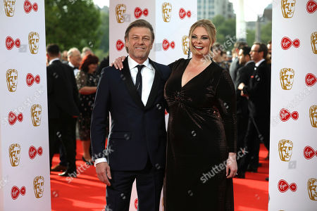 Stock Image of Sean Bean, Ashley Moore. Actor Sean Bean and Ashley Moore pose for photographers upon arrival at the British Academy Television Awards in central London