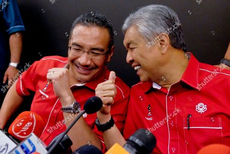 Ahmad Zahid Hamidi, Hishammuddin Hussein. Former Malaysian Deputy Prime Minister Ahmad Zahid Hamidi, right, speaks to former Defense Minister Hishammuddin Hussein, left, after a press conference in Kuala Lumpur, Malaysia, . Ahmad Zahid Hamidi had taken over as United Malays National Organization (UMNO) president after Najib Razak told a news conference on Saturday that he was stepping down as president of the UMNO and as chairman of the National Front coalition