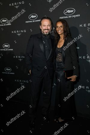 Vincent Perez, Karine Silla. Vincent Perez and Karine Silla pose for photographers upon arrival at the Kering Women In Motion awards at the 71st international film festival, Cannes, southern France