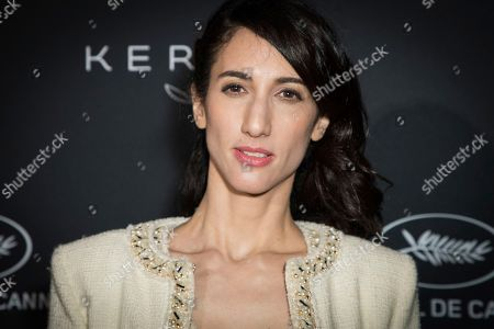 Director Deniz Gamze Erguven poses for photographers upon arrival at the Kering Women In Motion awards at the 71st international film festival, Cannes, southern France