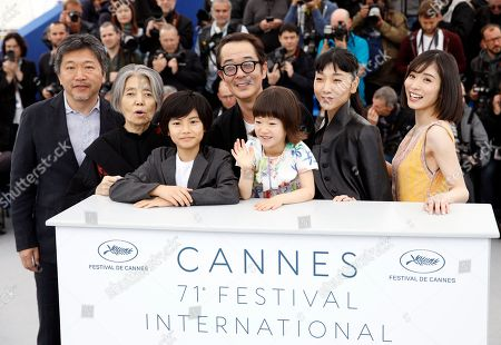 (L-R) Japanese director Hirokazu Kore-eda, Kirin Kiki, Jyo Kairi, Lily Franky, Miyu Sasaki, Sakura Ando and Mayu Matsuoka pose during the photocall for 'Shoplifters (Manbiki Kazoku)' at the 71st annual Cannes Film Festival, in Cannes, France, 14 May 2018. The movie is presented in the Official Competition of the festival which runs from 08 to 19 May.